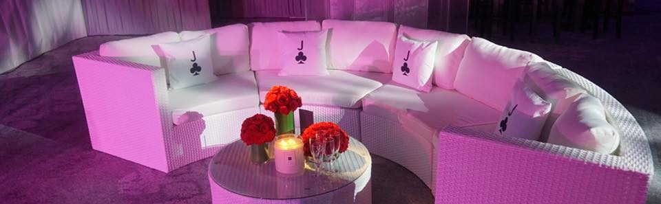 Bulgari curved sofa with flowers and candle