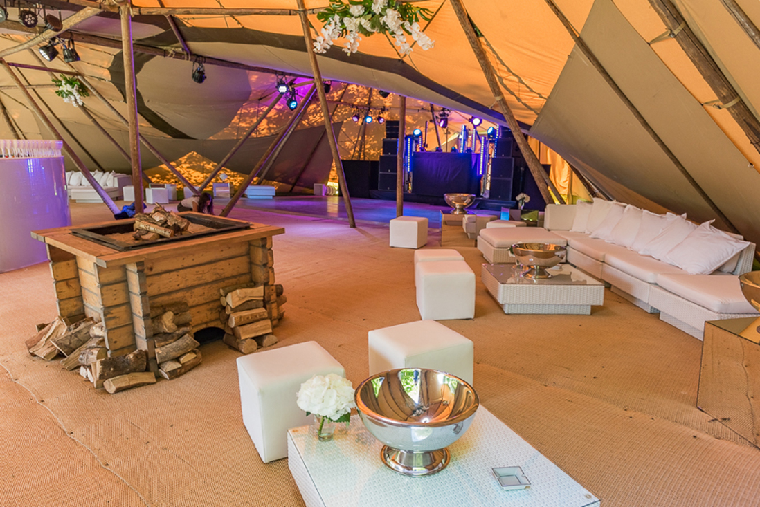 White rattan furniture hire set in rustic cocktail lounge in tipi