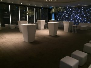 White poseur tables in VIP lounge