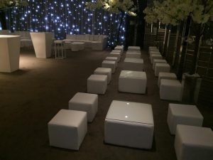 White faux leather cube seats and tables