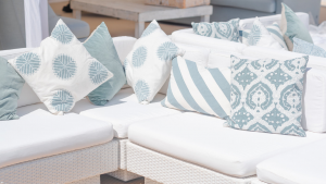 white rattan sofas with printed scatter cushions