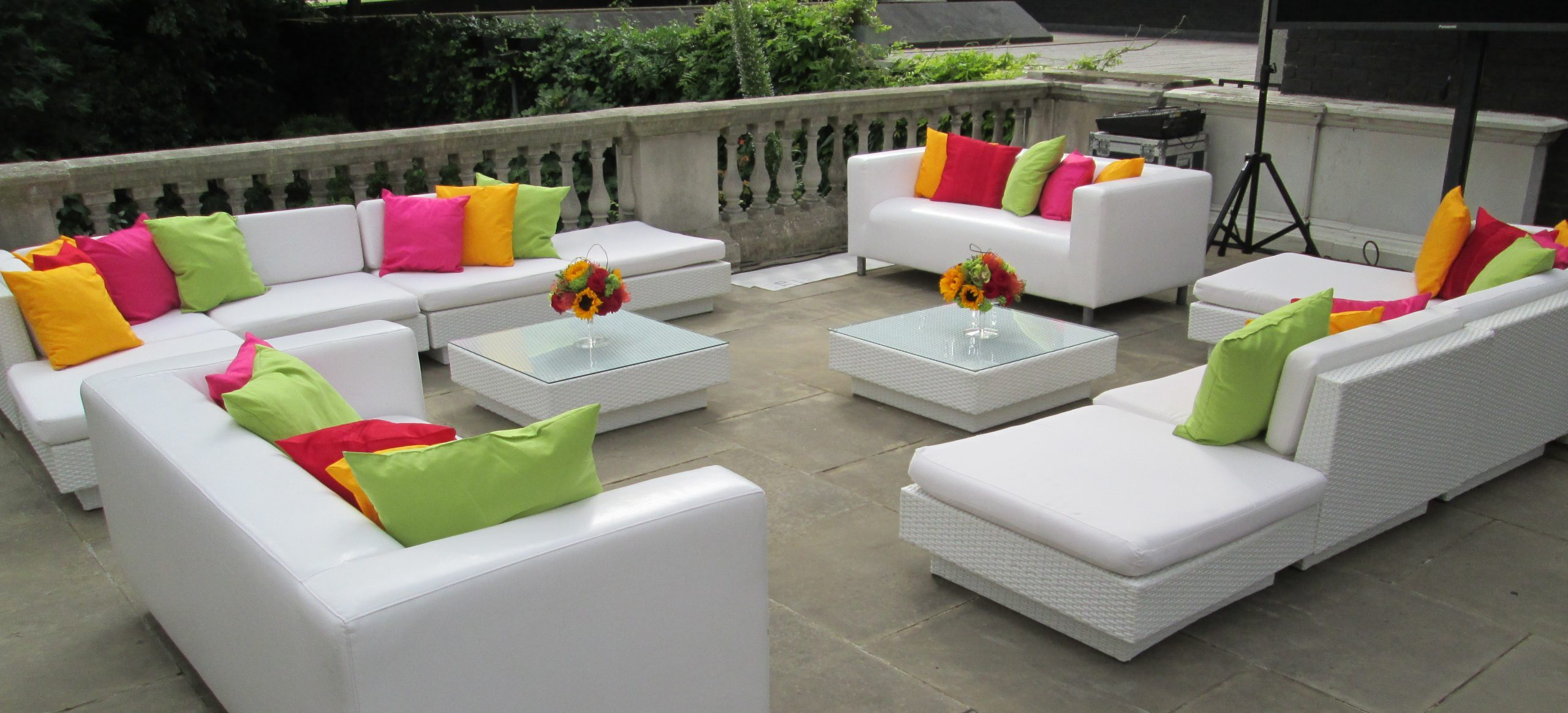 funky furniture hire: white sofas and bright scatter cushions