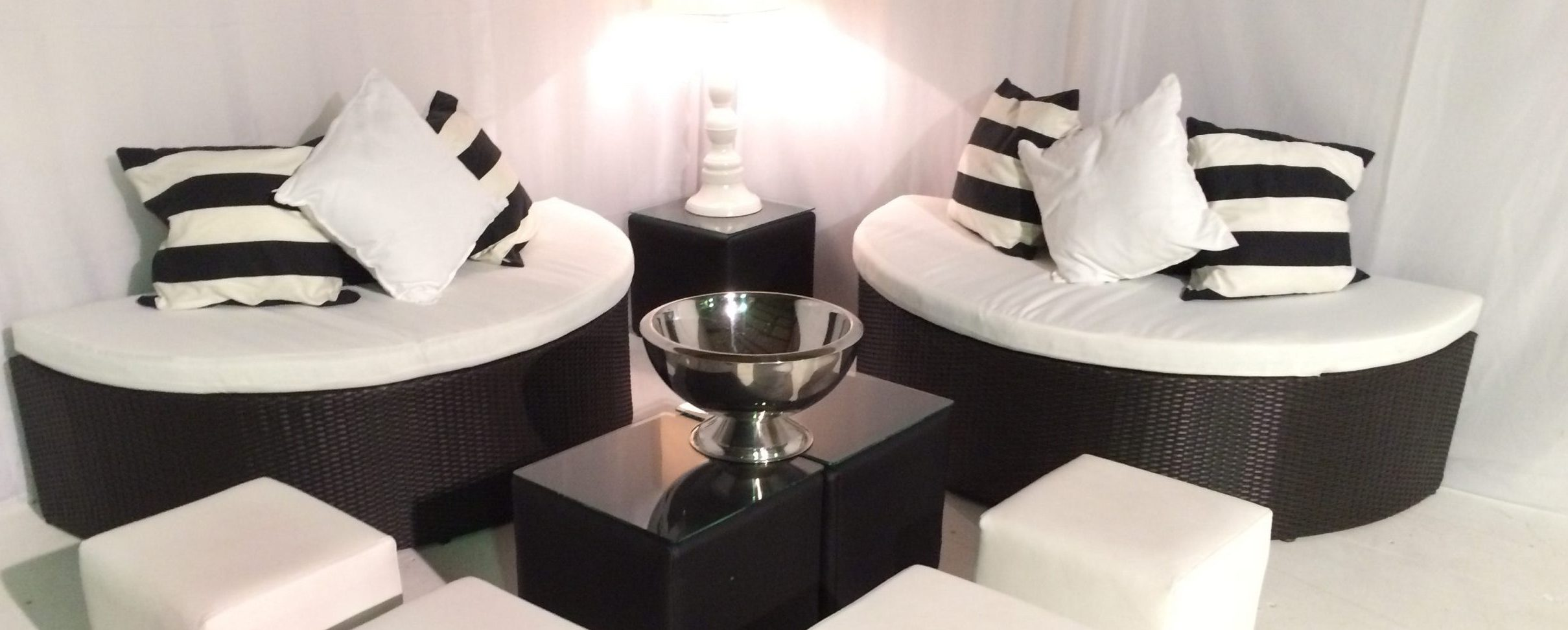 funky furniture hire: black circular sofas ottomans and tables