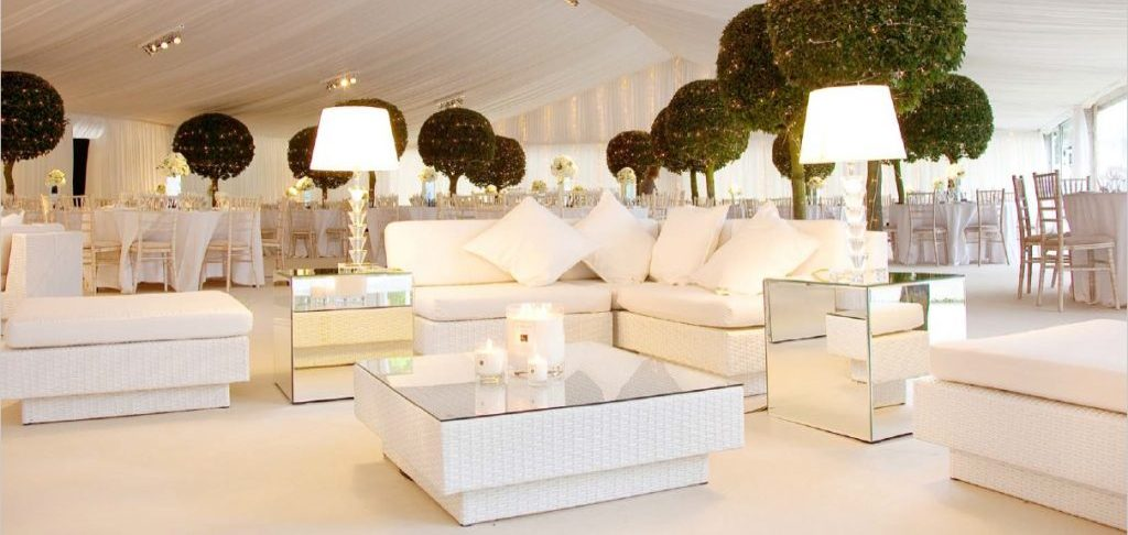 wedding furniture hire: white sofas and mirror cubes