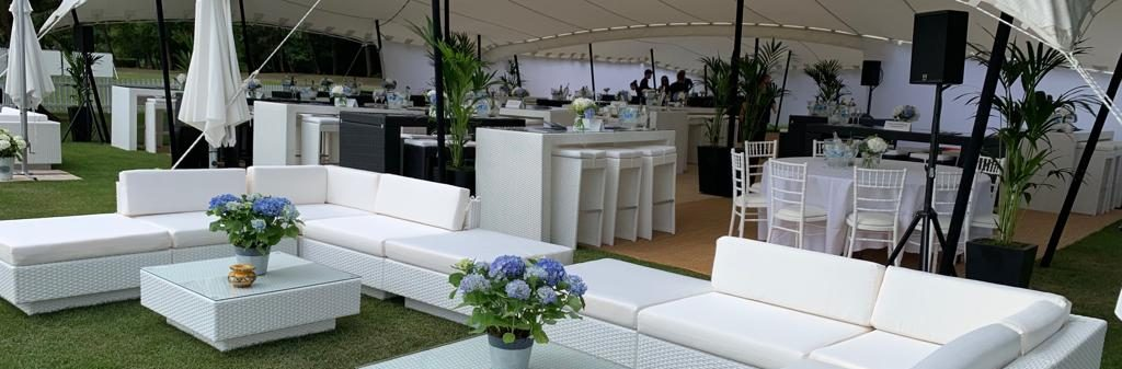 rattan furniture hire: white sofas and dining furniture